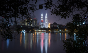Malaysia's landmark Petronas Twin Towers illuminates the night skyline in Kuala Lumpur. Malaysia's police chief said suspected militants were detained for allegedly plotting to carry out terrorist acts in the country's largest city. Photograph: Joshua Paul/AP